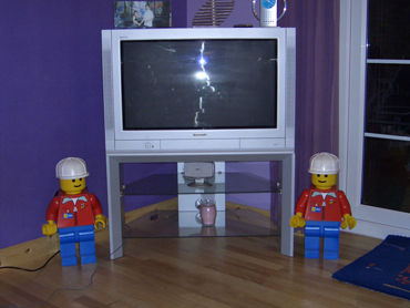 Giant minifigs guarding the TV